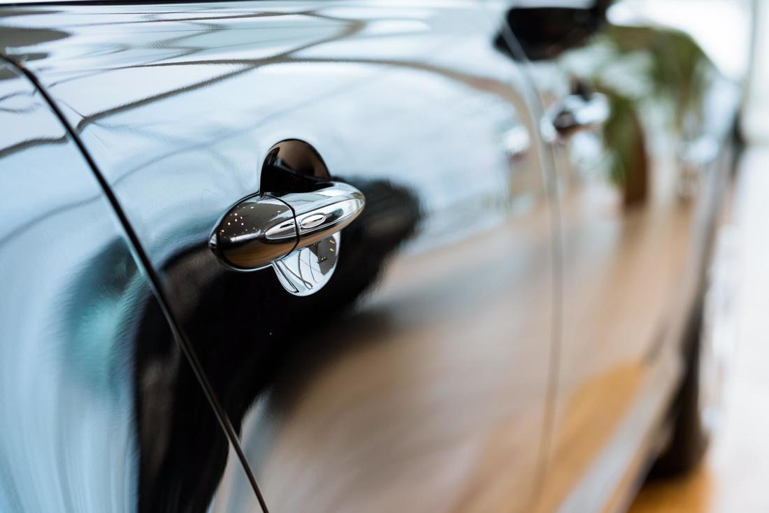 a shiny clean black car door handle